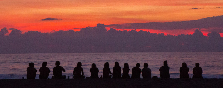 Group of friends by sunset